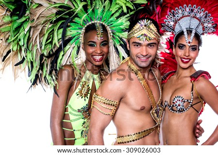 Samba dancers posing to the camera together - stock photo