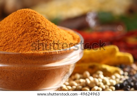 Sambar curry powder in a glass bowl along with all spice ingredients - stock photo