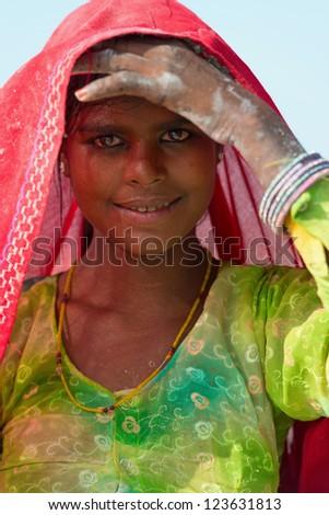SAMBHAR, INDIA - NOV 19: Portrait of indian female worker in salt farm on Nov 19, 2012 in Sambhar Salt Lake, India. It is India's largest saline lake, where salt has been farmed for a thousand years. - stock photo