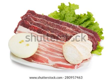 Samgyeopsal popular Korean dishes. Raw meat pork and beef cooked on the grill for roasting participants meal. From a series of Food Korean cuisine. - stock photo