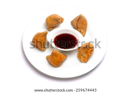 Samosa Indian traditional fast food snack dish isolated on white background - stock photo