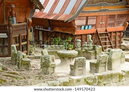 Samosir, Ambarita - Stone chairs used for judgement and executions. - stock photo