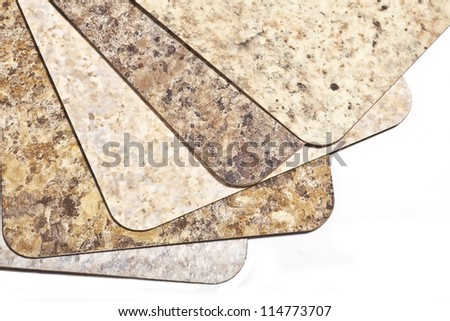 Samples of modern laminate flooring in earth tone shades. - stock photo