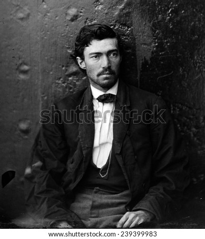 Samuel Arnold, a Lincoln Assassination conspirator in maniacals at the Washington Navy Yard. This photograph was taken on one of the monitors, U.S.S. Montauk and Saugus. - stock photo