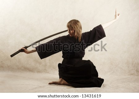samurai with blade sits - stock photo