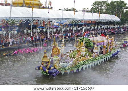 SAMUT PRAKAN - OCTOBER 29: One of several decorated barges in the floating parade at the annual Rap Bua Buddhist festival on the outskirts of Bangkok on October 29, 2012 in Samut Prakan, Thailand. - stock photo