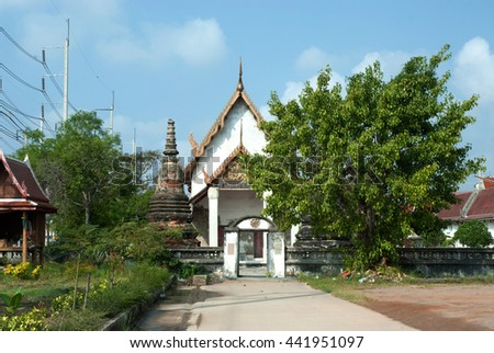 SAMUT SAKHON,THAILAND-DECEMBER 11,2010 : Here there is Wat Khok Kham an old chapel building that was once visited by King Rama 4.The gable of the chapel has a wooden engraving.,Samut Sakhon,Thailand.  - stock photo