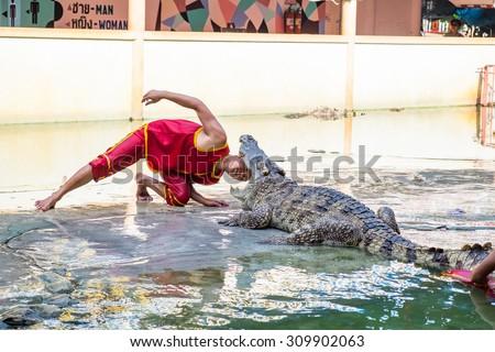 SAMUTPRAKARN,THAILAND - August 17: Crocodile show and man exciting and danger at crocodile zoo farm on August 17, 2015 in Samutprakarn,Thailand - stock photo