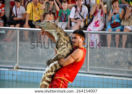SAMUTPRAKARN,THAILAND - FEBRUARY 4: crocodile show at crocodile farm on February 4, 2013 in Samutprakarn,Thailand. This exciting show is very famous among among tourist and Thai people - stock photo