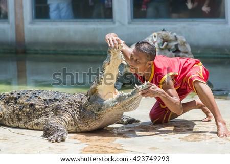 SAMUTPRAKARN,THAILAND - May 20: Crocodile show and man exciting and danger at crocodile zoo farm on May 20,2016 in Samutprakarn,Thailand - stock photo