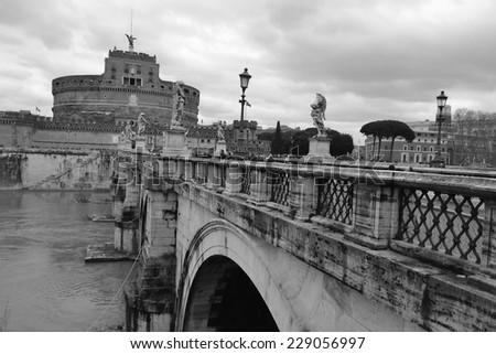 San Angelo bridge and castle in Rome, Italy. Black and white. - stock photo