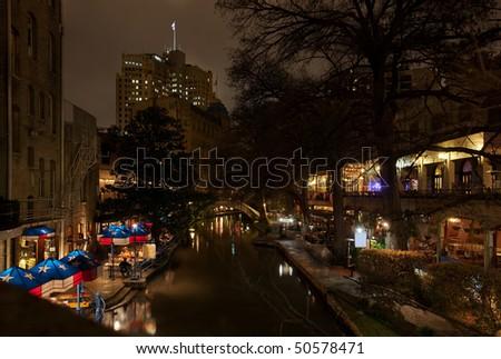 San Antonio Texas River Walk at night with Patios and restaurants - stock photo