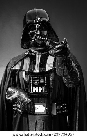 SAN BENEDETTO DEL TRONTO, ITALY. DECEMBER 5, 2014. Darth Vader costume replica portrait . Darth Vader or Dart Fener is a fictional character of Star Wars saga. Black background - stock photo