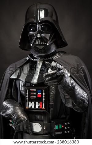 SAN BENEDETTO DEL TRONTO, ITALY. DECEMBER 5, 2014. Half-lenght portrait of Darth Vader costume replica. Darth Vader or Dart Fener is a fictional character of Star Wars saga. Black background  - stock photo