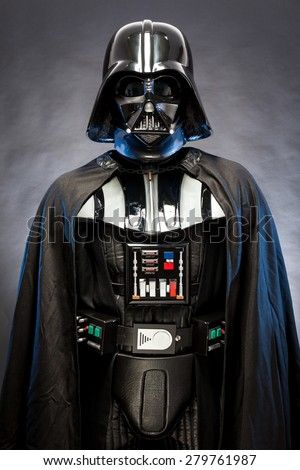 SAN BENEDETTO DEL TRONTO, ITALY. MAY 16, 2015. Half-lenght portrait of Darth Vader. Darth Vader is a fictional character of Star Wars saga. Black background. Blue grazing light - stock photo