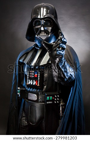SAN BENEDETTO DEL TRONTO, ITALY. MAY 16, 2015. Portrait of Darth Vader costume replica with grab hand . Darth Vader is a fictional character of Star Wars saga.  Blue grazing light - stock photo