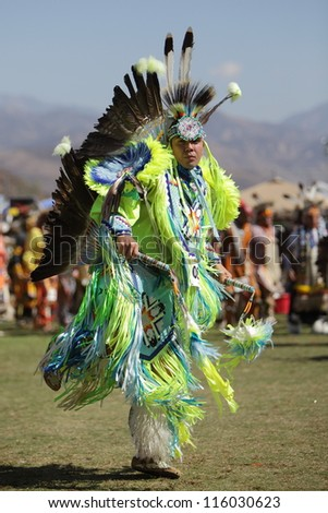 SAN BERNARDINO, CALIFORNIA - OCTOBER 13: The San Manuel Band of Indians hold their annual Pow Wow on October 13, 2012 in San Bernardino. A tribal warrior performs the Fancy Dance. - stock photo