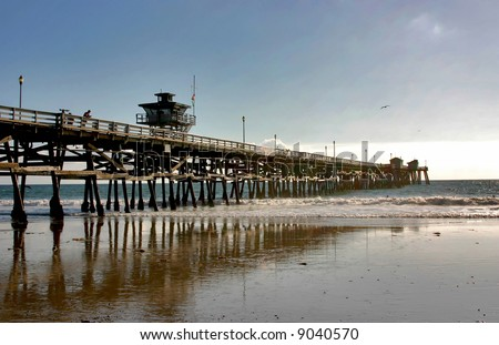 San Clemente Pier and reflection at Low Tide during Winter - stock photo
