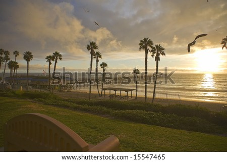 San Clemente Sunset Pier after a storm with Sea gulls - stock photo