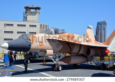 SAN DIEGO CA USA APRIL 07 2015: The McDonnell Douglas  (now Boeing) F/A-18 Hornet is a twin-engine supersonic, capable multirole combat jet, designed as both a fighter and attack aircraft.  - stock photo