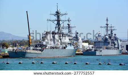 SAN DIEGO CA USA APRIL 09 2015: USS Benfold (DDG-65) is an Arleigh Burke-class destroyer and USS Mobile Bay (CG-53) is a Ticonderoga class guided-missile cruiser serving in the United States Navy. - stock photo