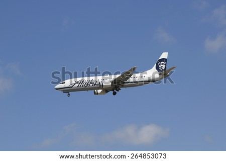 SAN DIEGO, CALIFORNIA - SEPTEMBER 27, 2014: Alaska Airlines Boeing 767 jet descending for landing San Diego International Airport. Alaska Airlines is the seventh largest US air carrier. - stock photo