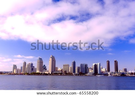 San Diego city skyline at sunset, showing the buildings of downtown rising above harbor viewed from Coronado Island. - stock photo