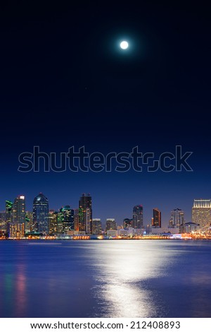 San Diego downtown skyline and full moon over water at night - stock photo