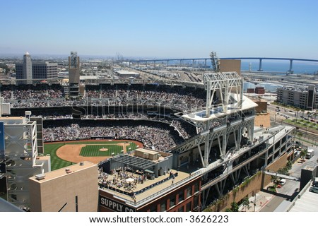 San Diego's Petco Park, Coronado Bridge in the background. - stock photo