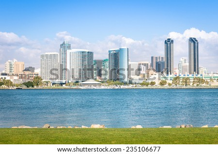 San Diego skyline and waterfront with blue water and green meadow - Skyscrapers from Coronado Island in California - United States - stock photo