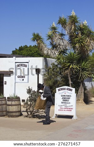SAN DIEGO, USA - AUGUST 22 2013: Man with an old hat inside the Old Town San Diego State Historic Park - stock photo