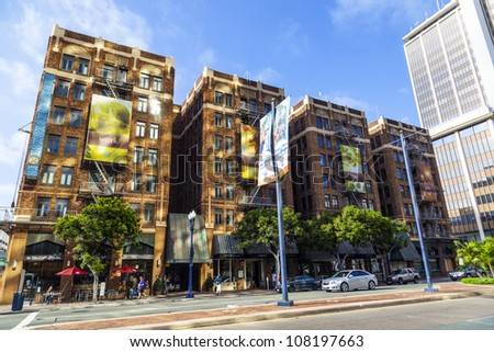 SAN DIEGO, USA - JUNE 11: facade of old houses in the gaslamp quarter on June 11, 2012 in San Diego, USA. The area is a district on the National Register of Historic Places and dates back to 1867. - stock photo