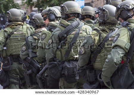 SAN DIEGO, USA - MAY 27, 2016: Riot police stand in formation ready to confront protesters at an anti-Trump rally at the San Diego Convention Center - stock photo
