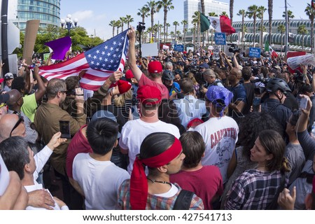 SAN DIEGO, USA - MAY 27, 2016: Tensions rise as anti-Trump protesters meet Trump supporters at a Donald Trump rally at the San Diego Convention Center. - stock photo