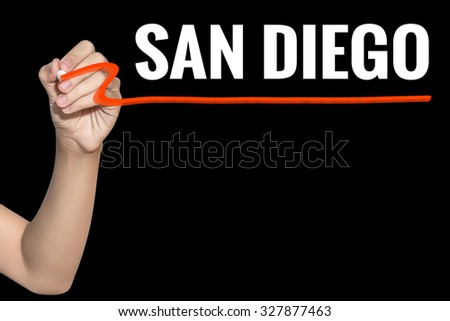 San Diego word write on black background by woman hand holding highlighter pen - stock photo