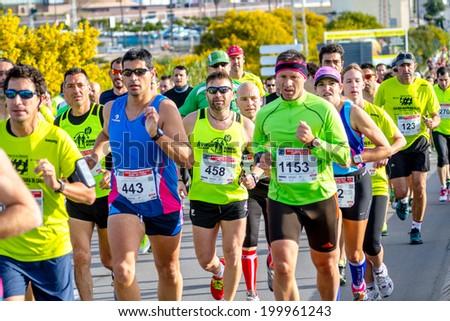 SAN FERNANDO, SPAIN - MAR 23: Unidentified runners on the street during XXVIII Half Marathon Bahia de Cadiz on March 23 , 2014, in San Fernando , Spain - stock photo