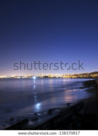 San Francisco and the Bay sparkle beneath a brilliant starry sky - stock photo