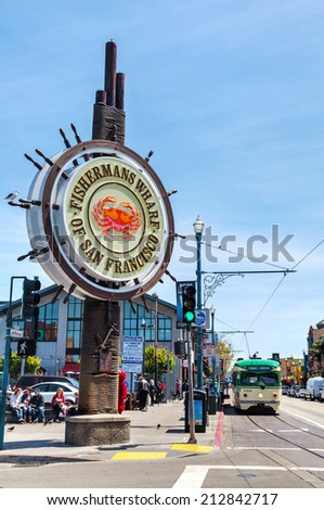 SAN FRANCISCO - APRIL 24: Famous Fisherman's Wharf sign on April 24, 2014 in San Francisco, California. It's one of the busiest and well known tourist attractions in the western United States. - stock photo