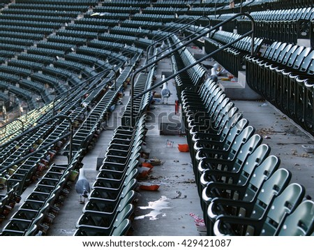SAN FRANCISCO - AUGUST 12: Seagulls roam the upper deck for food after the ending of a baseball game after fans have left the ballpark.  August 12  2010 Att Park San Francisco California.  - stock photo