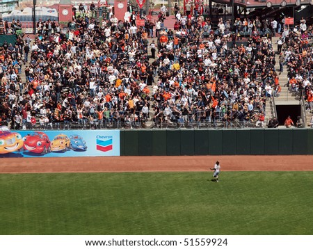 SAN FRANCISCO, CA - APRIL 14: San Francisco Giants vs. Pirates: Pirates Lasting Milledge chases after a homerun ball as it floats out the park. April 14, 2010 AT&T Park San Francisco California. - stock photo