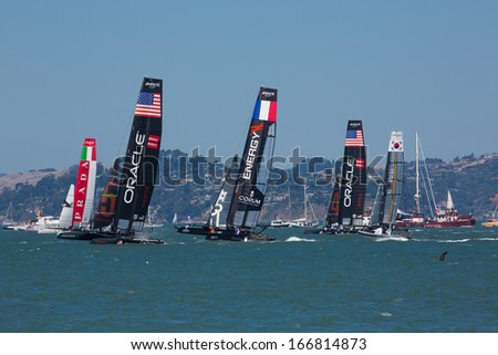 SAN FRANCISCO, CA, AUGUST 26: A few teams try to overtake the Italian team in the bay of San Francisco during the final of the America's Cup 2012. - stock photo