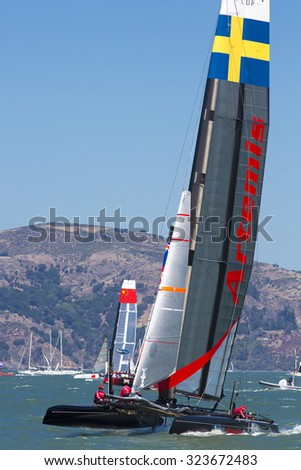 SAN FRANCISCO, CA, AUGUST 26: Sweden catamaran team sailing during the final of the America's Cup World Series competition in San Francisco. USA 2012 - stock photo