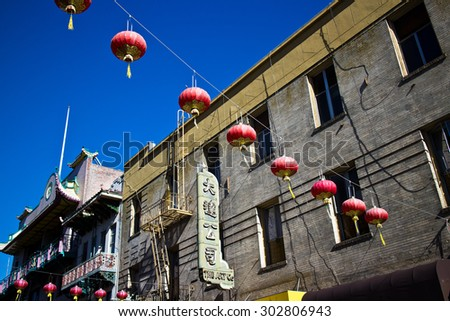 SAN FRANCISCO, CA - CIRCA MARCH 2015 - Red Lanterns hang across a street in Chinatown, San Francisco USA, attesting to the great melting pot of America due to the influx of immigrants over the years. - stock photo