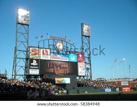 SAN FRANCISCO, CA - JULY 28: ATT Park HDTV Scoreboard in the outfield bleachers displays 'Let's Go Giants' in the final inning to rally the fans.   July 28, 2010 San Francisco California. - stock photo