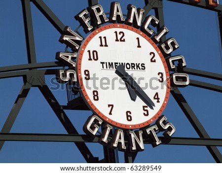 SAN FRANCISCO, CA - JULY 28: Giants Scoreboard Clock, designed by Steve Kowalski with TimeWorks logo in the center, displaying the time of about 5:23 July 28, 2010 ATT Park San Francisco California. - stock photo