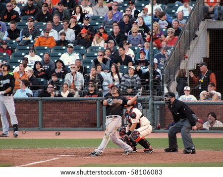 SAN FRANCISCO, CA - JULY 28: Giants Vs. Marlins: Marlins Dan Uggla connects with a home run with Buster Posey catching at AT&T Park July 28, 2010 in San Francisco, California. - stock photo