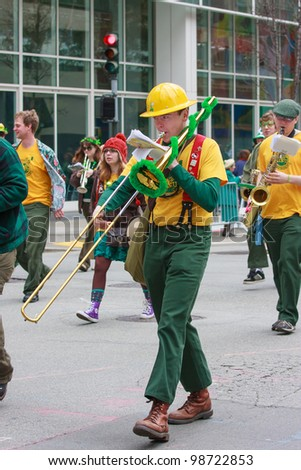 SAN FRANCISCO, CA - MARCH 17: An unidentified man playing trombone during the St. Patric's Day Parade, March 17, 2012 in San Francisco, CA - stock photo