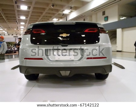 SAN FRANCISCO, CA - NOVEMBER 20: Chevy Volt on display on a spinning platform at the 53rd San Francisco International Auto Show, on Saturday November 20 2010 San Francisco California. - stock photo