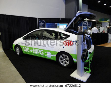 SAN FRANCISCO, CA - NOVEMBER 20: The AAA Emergency Road Service plug-in 100+ MPG Toyota Prius automobile is displayed at Auto Show, on November 20, 2010 San Francisco, California. - stock photo