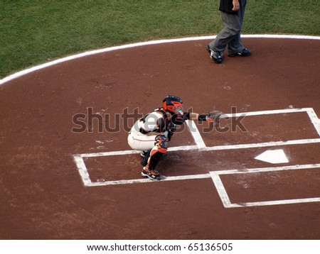 SAN FRANCISCO, CA - OCTOBER 20: Buster Posey sets to catch ball with glove during between inning warm-ups game 4 2010 NLCS game between Giants and Phillies Oct. 20, 2010 AT&T Park San Francisco, CA. - stock photo